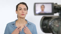 Actress in a TV production stand and talk in front of professional video came Stock Footage