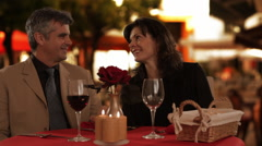 Mid aged couple dining in town Stock Footage