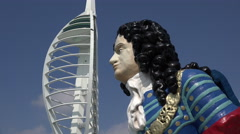 Figurehead statue and spinnaker tower gunwharf quays, portsmouth, england Stock Footage