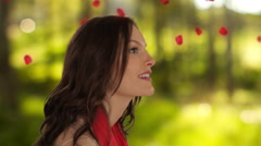 Dolly shot of young girl with falling petals Stock Footage