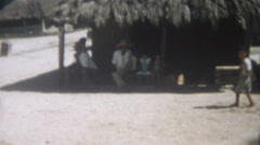 Vintage Film 1956 Yoza Okinawa Japan- Native People Sit Shade Thatched Roof Boy Stock Footage