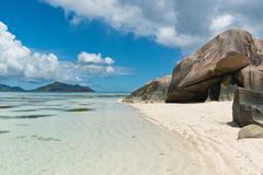 Boulders on beach coastline in seychelles Stock Photos