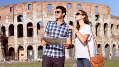 Young Couple Tourists Visit Rome Coliseum Map Directions Happy Stock Footage