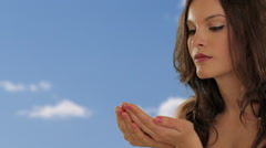 Young girl blowing petals from hands Stock Footage