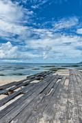 Dilapidated wooden boardwalk at anse union Stock Photos