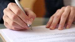 Woman signing a contract with a Fountain Pen Stock Footage