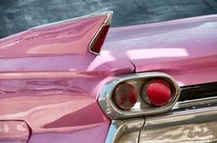 close up of taillight and fin of pink cadillac - stock photo