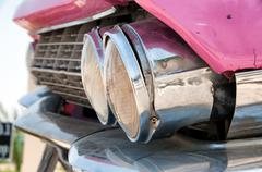 Detail of headlights of classic pink cadillac Stock Photos