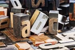 antique letterpress printing blocks, letters abc - stock photo