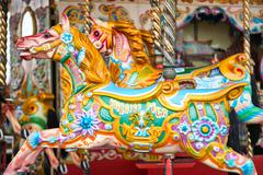 Beautiful decorated horse on a merry-go-round Kuvituskuvat