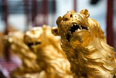Detail of gold lions on ship at maritime museum Stock Photos
