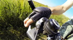 Man rides a bike. Close-up of the steering wheel and hand in a glove. Stock Footage