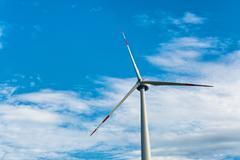 single wind turbine providing sustainable energy - stock photo