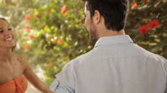 Young couple hugging with present in park Stock Footage