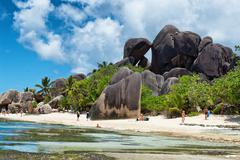 large rocks in front anse source d'argent beach - stock photo