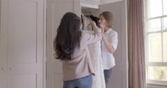 Women holding dress Stock Footage