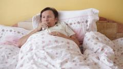 Ill senior woman coughing Stock Footage