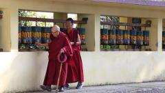 Old tibetan buddhist monk turning the prayer wheels at temple, Dharamsala, India Stock Footage