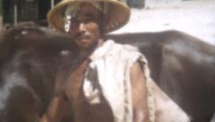 Vintage Film 1956 Yoza Okinawa Japan- Man Saipan Hat With Horse Stares Close Up - stock footage
