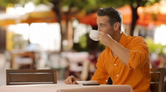 Young couple sitting in cafe with shopping bags. - stock footage