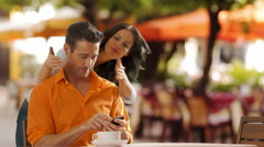 Young couple sitting in cafe meeting and hugging. Stock Footage