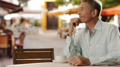 Senior couple sitting in cafe with shopping bags. - stock footage