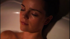 Woman relaxing in bath Stock Footage