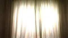 Woman opening curtains to morning light Stock Footage
