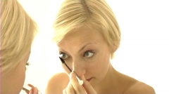 Woman applying mascara - stock footage