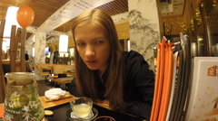 The girl drinks tea in a Japanese restaurant Stock Footage