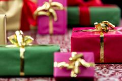 wrapped presents with bows in gold and red - stock photo