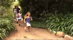 Family in Park running with ball - stock footage