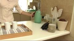 Woman making tea Stock Footage