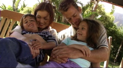 Family on swing hammock, hugging - stock footage