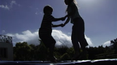 Children on trampoline Stock Footage