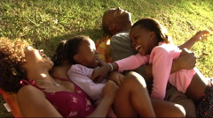 Family in Park hugging Stock Footage