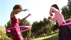 Family in park with hula hoop Stock Footage