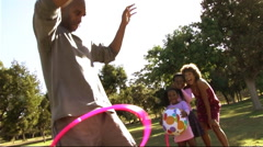 Family in park with hula hoop - stock footage