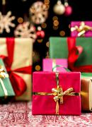 Christmas background with gifts and glitters Stock Photos