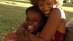Mother and daughter hugging Stock Footage