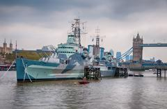 Hms belfast moored in the river thames Stock Photos