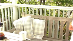 Woman drinking coffee on veranda Stock Footage