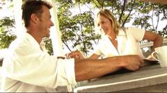Couple on veranda, playing together Stock Footage