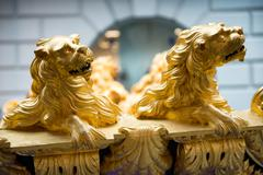 detail of gold lions on ship in maritime museum - stock photo