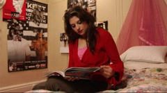 Teenage Girl at home/ reading magazine/ greeting friends Stock Footage