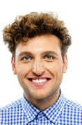 Portrait of a happy man with curly hair on a white background Stock Photos
