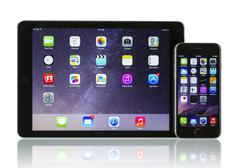 Apple space gray iphone 6 and ipad air 2 wi-fi + cellular - stock photo