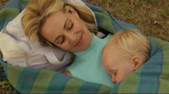 Mother and Baby asleep in Park Stock Footage