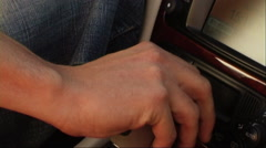 Man with hand on gear lever, woman puts hers on top - stock footage