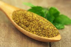 grated mustard seeds with green herbs - stock photo